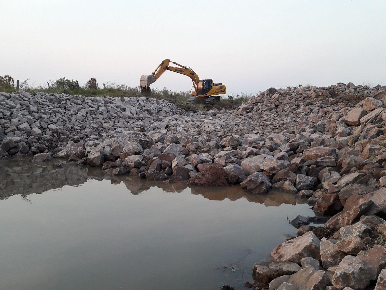 Construccion de canales y reservorios arroceros